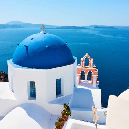 Greece, Santorini Island. Scenic view with white church by the sea in Oia. Greek landscape Standard-Bild