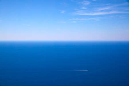 Seascape with sea horizon and blue sky,  may use as background with copy space Standard-Bild