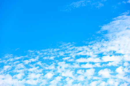 Sky with small white clouds. Background with copy space Standard-Bild