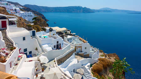 Santorini Island in Greece. Panoramic view of Oia town small white houses by the sea. Greek landscape