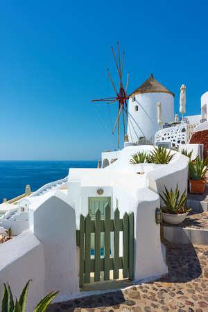 Santorini island in Greece. Scenic view with white windmill Standard-Bild