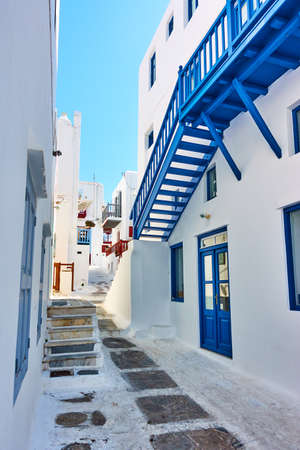 Street in Mykonos island in Greece on sunny summer day.  Greek architecture, cityscape