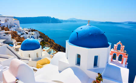 Greece, Santorini Island. Scenic view with blue domes of old greek church by the sea in Oia