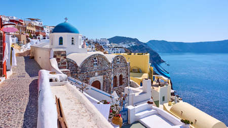 Greece, Santorini island. Scenic panoramic view with street and ancient greek church in Oia town