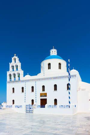 Church of Panagia Platsani in Oia in Santorini Island against the blue sky, Greece. Greek architecture