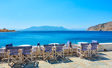 Aegina Island in Greece. Open air cafe by the sea in Perdika village Standard-Bild