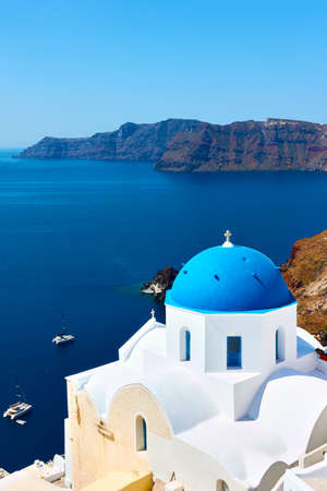 Greece, Santorini Island. Scenic view with white church on the coast on the high coast by the sea. Greek landscape