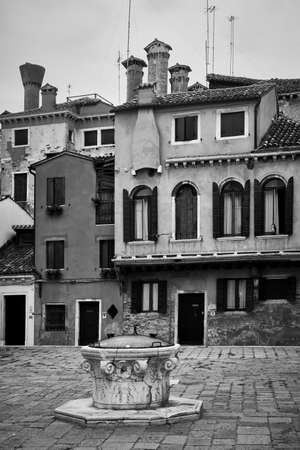 Small square in Venice, Italy. Venetian cityscape, black and white photography