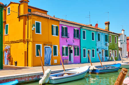 Cozy colorful houses by canal in Burano Island in Venice, Italy. Cityscape, venetian view Standard-Bild