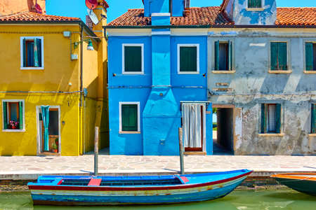 Houses by canal in Burano in Venice, Italy. Colorful venetian view