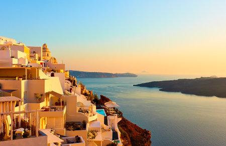Sea and Fira town in Santorini island in Greece at sunset