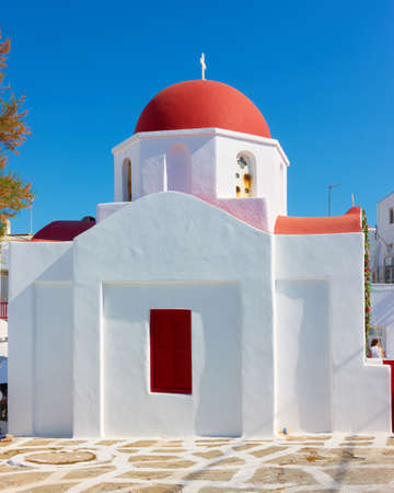 Greek church with red dome in Mykonos, Greece