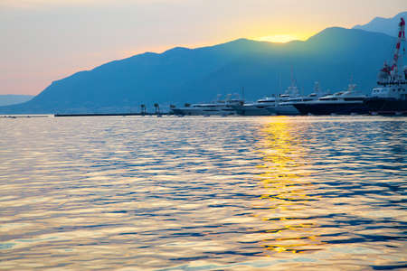 The Bay of Kotor at sunset and Porto Montenegro marina in the background. Tivat, Montenegro