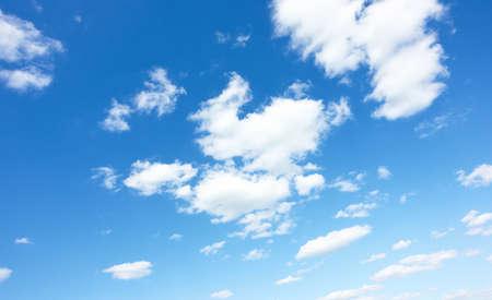 Blue sky with clouds. Background Standard-Bild