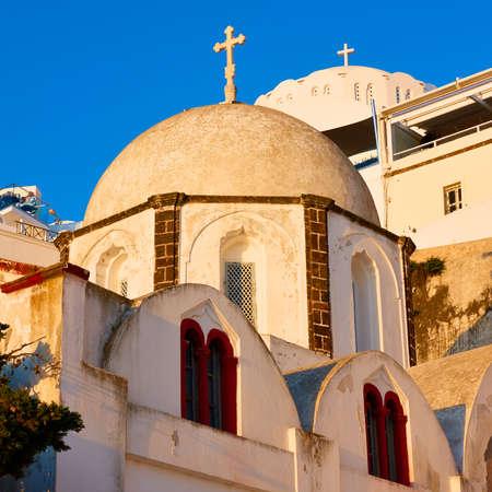 Domes of greek churches at sunset, Santorini, Greece