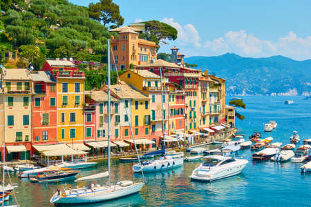 Portofino in Italy. View of the waterfront and boats in the harbour. Landscape, italian scenic view