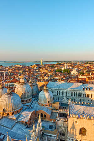 Venice city with domes of Cathedral Basilica of Saint Mark at sunset. Panoramic view with space for text 版權商用圖片
