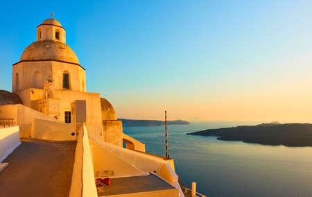 Santorini island in Greece at sunset. Landscape with Aegean Sea