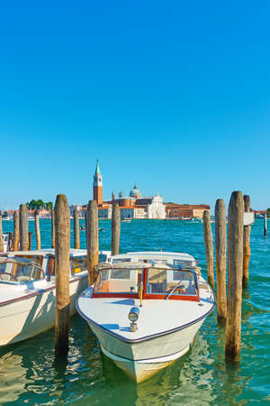 Water taxi in Venice, Italy. Pier with moored motorboat. Venetian public transport