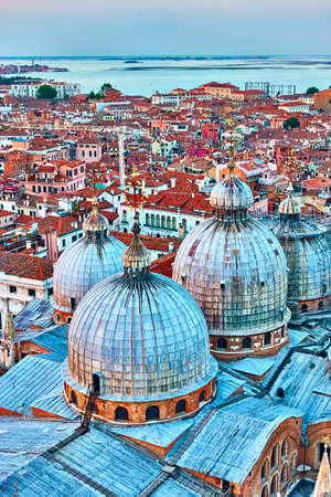 Domes of Cathedral Basilica of Saint Mark and Venice at twilight. Panoramic view, cityscape Banco de Imagens