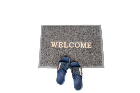 welcome mat: a straw hessian welcome mat matt isolated on a white background
