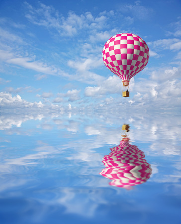 3d balloons in the blue sky and reflection in water photo