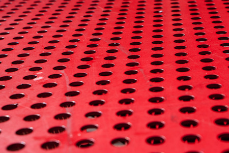 metal grate: Red metal grate texture and background Stock Photo
