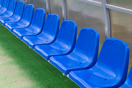 blue rows of seats on the stadium.