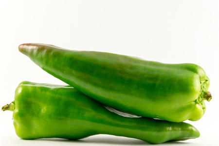 Green pepper on white background.