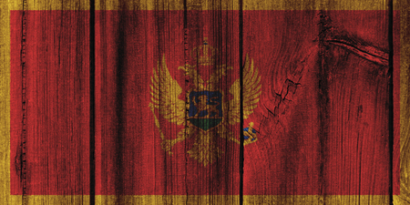 Montenegro  flag painted on wooden wall for background. Stock Photo