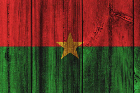 Burkina Faso  flag painted on wooden wall for background.