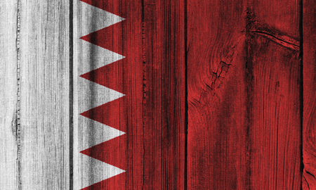 Bahrain  flag painted on wooden wall for background.