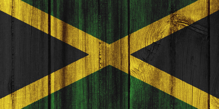 Jamaica  flag painted on wooden wall for background.