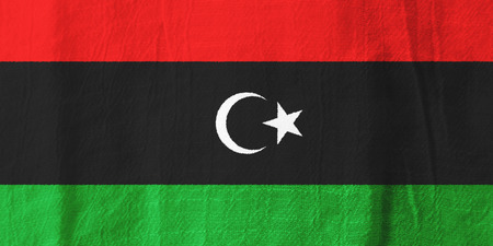 libya: Libya national flag from fabric for graphic design. Stock Photo