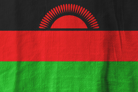 Malawi national flag from fabric for graphic design. Stock Photo