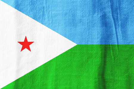 djibouti: Djibouti national flag from fabric for graphic design. Stock Photo