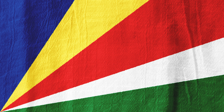 The Seychelles national flag from fabric for graphic design. Фото со стока