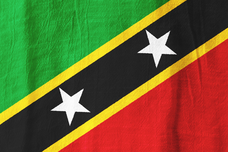 Saint Kitts and Nevis national flag from fabric for graphic design.