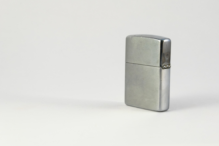 brushed steel: silver metal  lighter isolated on white.