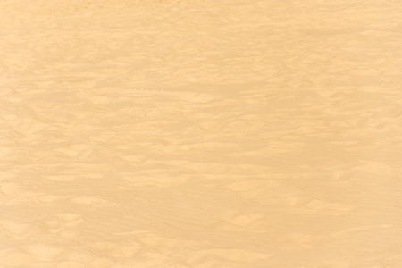 closeup of sand pattern of a beach in the summer. Stock Photo