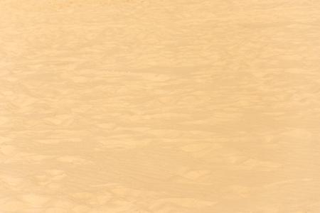 closeup of sand pattern of a beach in the summer. 免版税图像
