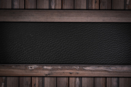 black leather texture pattern on wooden background.