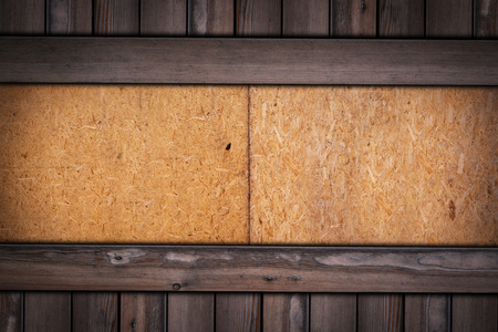 Pressed Wooden Panel  texture on wooden background.