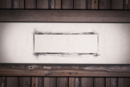 white wall with painted frame on wooden background.
