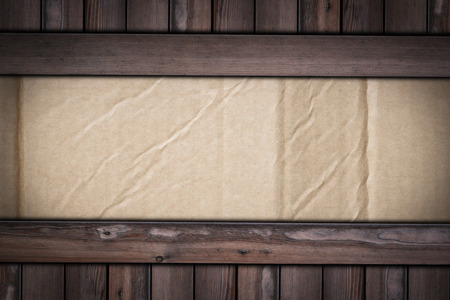 old cardboard texture on wooden background for graphic designers.