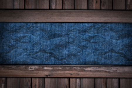 abstract blue jeans texture on wooden background.