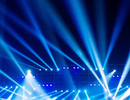 nightclub party: multiple spotlights on a theatre stage lighting rig