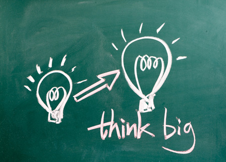 think big and light bulb on blackboard photo