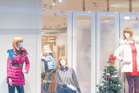 window display: Boutique display window with mannequins in fashionable dresses Stock Photo