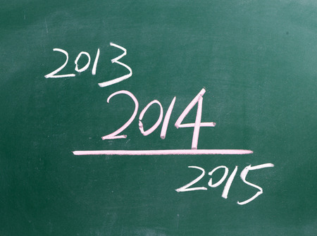 2014 written on blackboard  photo